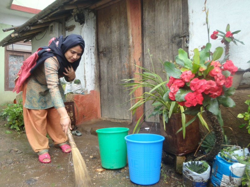 NCDC staff promoting sanitation activity and dustbin culture in community